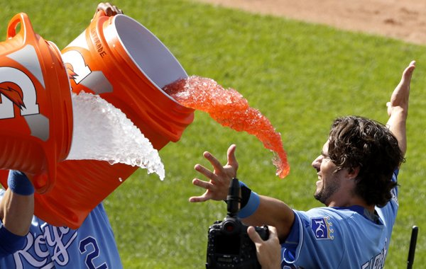Kansas City Royals' Brett Eibner is doused by teammates after hitting the game-winning single during the ninth inning of a baseball game against the Chicago White Sox on Saturday, May 28, 2016, in Kansas City, Mo. The Royals rallied for seven runs in the inning and won 8-7. (AP Photo/Charlie Riedel)