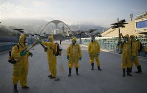 Health workers get ready to spray insecticide on Jan. 26 to combat mosquitoes that transmit the Zika virus under the bleachers of the Sambadrome in Rio de Janeiro, which will be used for the Archery competition in the 2016 summer games.