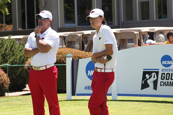 Arkansas coach Brad McMakin, left, talks with Charles Kim during the second round of the NCAA Championships on Saturday, May 28, 2016, at Eugene Country Club in Eugene, Ore.