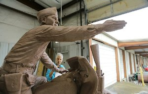 Kevin Kresse sculpts finishing details Oct. 23 on his monumental likeness of Gen. William O. Darby in a work shed attached to the Martin Borchert Co. in North Little Rock.