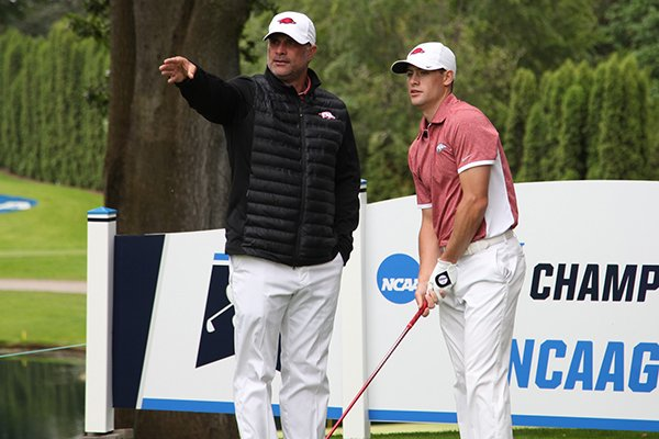 Arkansas golf coach Brad McMakin talks with Taylor Moore during the first round of the NCAA Championships on Friday, May 27, 2016, at Eugene Country Club in Eugene, Ore.