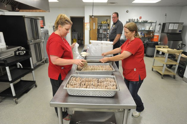 kim-bartlett-from-left-danny-beard-child-nutrition-director-and-tammy-wilson-prepare-lunch-friday-at-the-west-fork-elementary-school-cafeteria