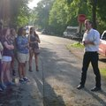 Dakota Buck leads a ghost tour Wednesday in front of Penn castle in Eureka Springs. Neighbors have c...