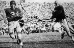 University of Arkansas football player Preston Carpenter, left, outruns Ole Miss players as he heads for the end zone to score giving Arkansas the 6-0 win at War Memorial Stadium in Little Rock, Ark., on Oct. 23, 1954. The game was played before the stadium's first overflow crowd of 38,000, and began the modern era of fan dedication to the Razorbacks. (AP Photo/Arkansas Democrat-Gazette, File)
