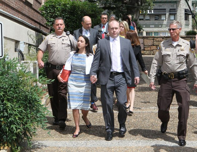 judge-wade-naramore-center-and-his-wife-ashley-naramore-are-escorted-around-the-garland-county-courthouse-after-a-pretrial-hearing-friday-june-3-2016-the-sentinel-recordrichard-rasmussen