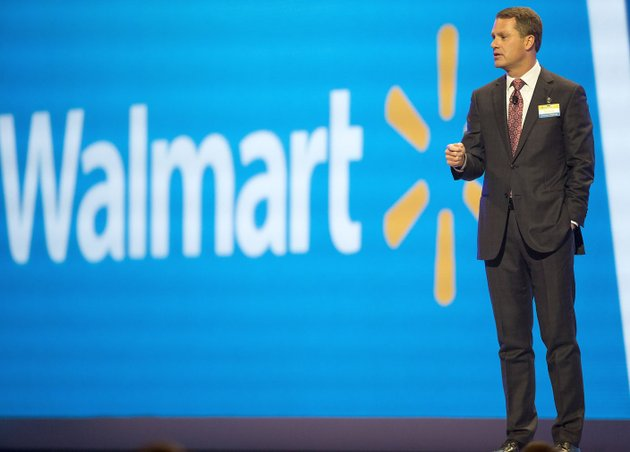 nwa-democrat-gazettejason-ivester-doug-mcmillon-chief-executive-officer-and-president-talks-on-stage-during-the-annual-wal-mart-shareholders-meeting-on-friday-june-3-2016-at-bud-walton-arena-in-fayetteville