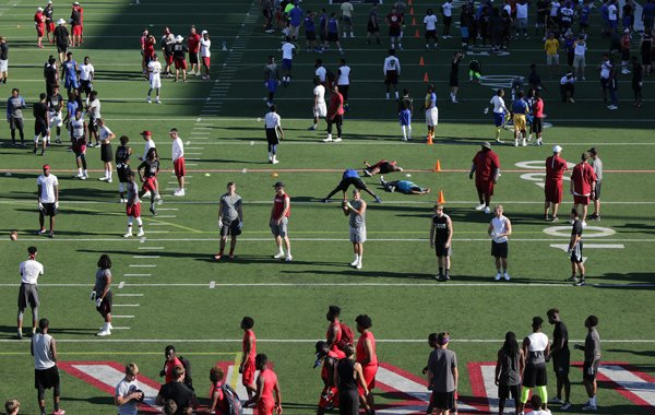 Players warm up before the start of the All Arkansas satellite camp Sunday, June 5, 2016, at War Memorial Stadium in Little Rock.