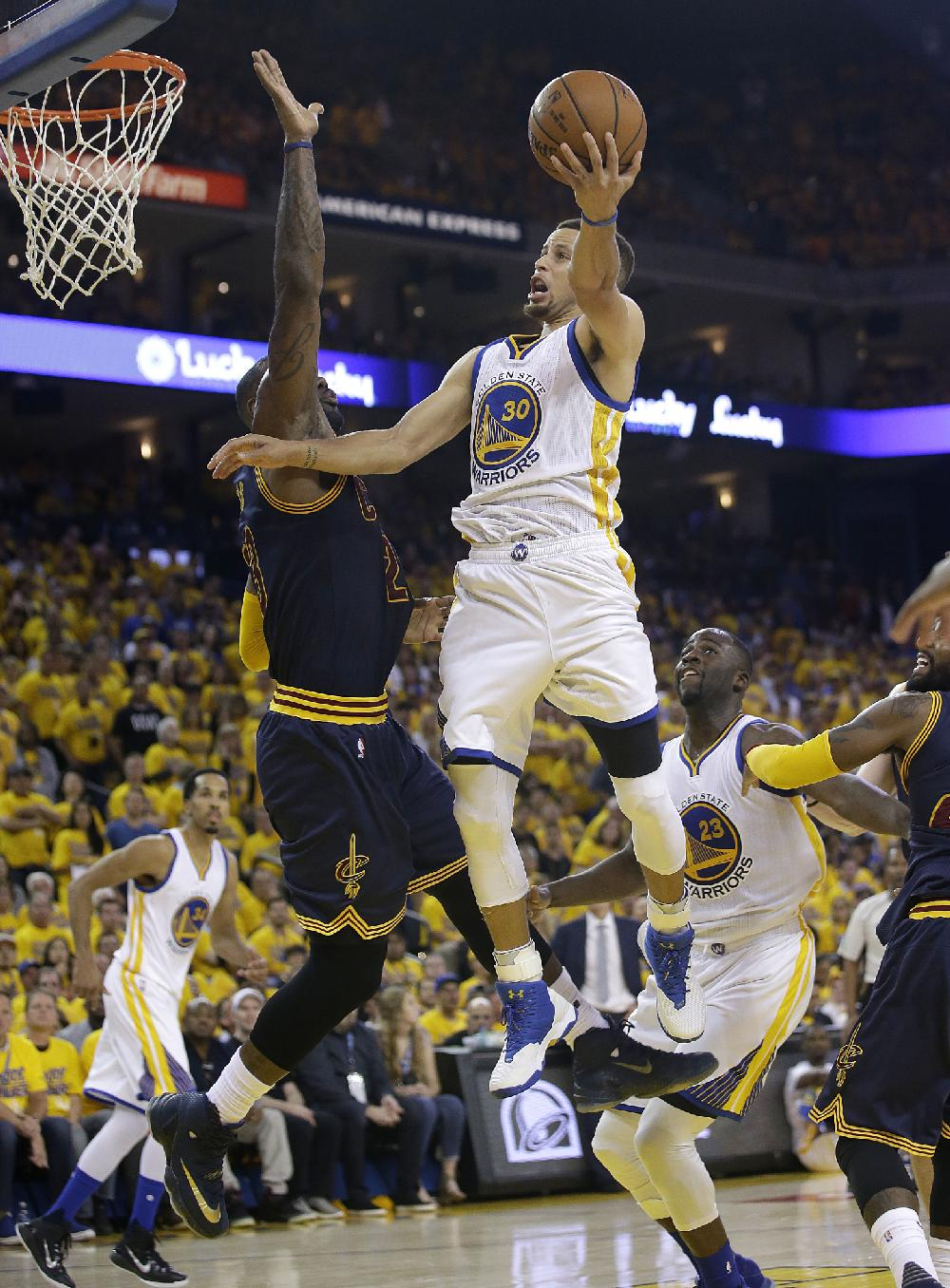 Golden State guard Stephen Curry puts up a shot over ...
