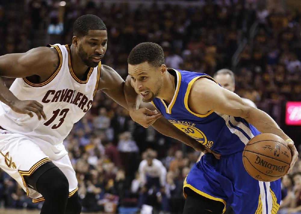Golden State guard Stephen Curry (right) looks for room ...