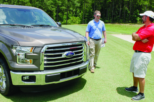 Truck: Jimmy Langley, left, of Smackover Motors presents Jeremy Jerry with a brand new Ford F-150 pickup truck. Jerry won the truck after using a 6-iron and hitting the ball 175 yrds for a hole-in-one on the fourth hole at Mystic Creek Golf Course during the 'Delek Tournament for Hope' at El Dorado. This is the fourth year for the 3-day golf tournament, which also includes a skeet shoot, cook-off, dinner and reception. Proceeds from the event benefit 13 local charities-American Cancer Society's Relay for Life, Boys and Girls Club of El Dorado, Agapé House Helping Hands Food Bank, Hope Landing, Turning Point, Character First, Ducks Unlimited of Union County, H.O.P.E. Development Center, the South Arkansas Community College Foundation, United Way of Union County, Camp Fire El Dorado and Hannah Pregnancy Center.