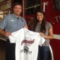 Bentonville Fire Department Capt. Hunter Smith and Kirstyn Tureman hold a T-shirt Tureman designed f...
