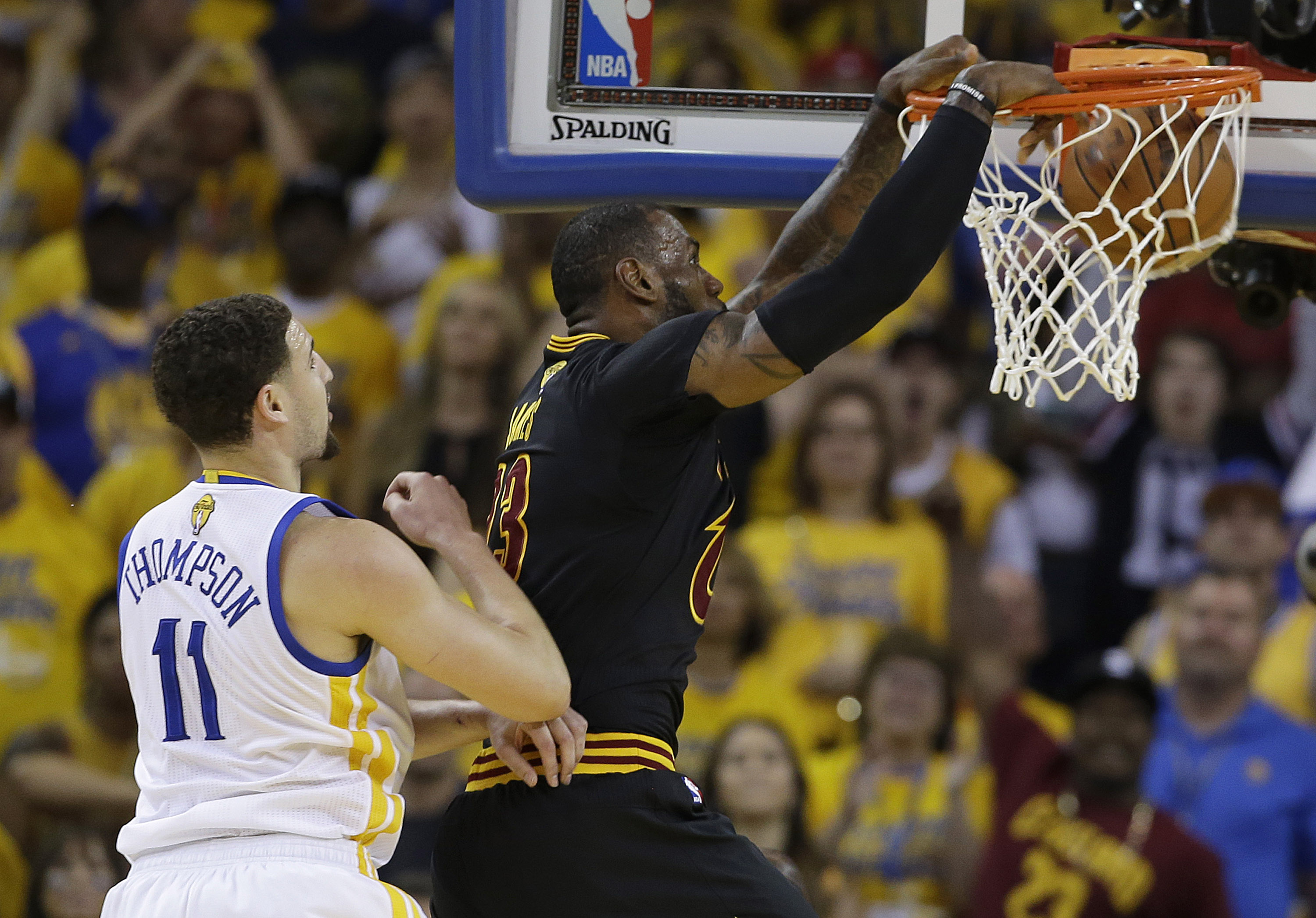 Cleveland Cavaliers forward LeBron James, right, dunks in ...
