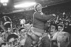 Arkansas coach Lou Holtz is carried by his players after defeating Oklahoma at the Orange Bowl in Miami, in this Jan. 2, 1978 photo. (AP Photo/Phil Sandlin)