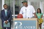 Philander Smith College president, Roderick Smothers, left, intorduced former Razorback and NBA basketball player, Todd Day, center, as the school's new head coach on the school's campus in Little Rock on Wednesday, June 15, 2016.