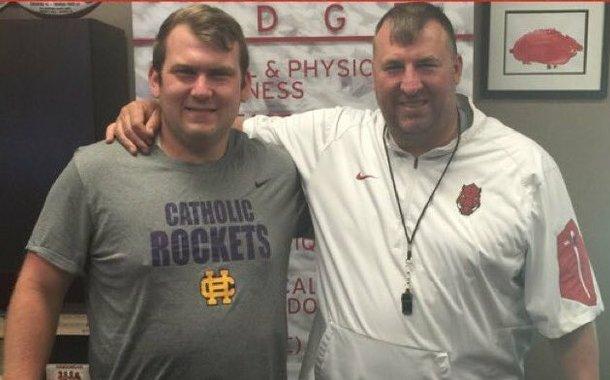 Little Rock Catholic offensive lineman Audry Horn and Arkansas Coach Bret Bielema.