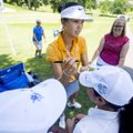 Michelle Wie autographs hats Wednesday for Taylor Johnson (left), 15, and Alesia Gonzalez, 16, both ...