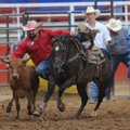 Jon Carpenter of Whiteboro, Texas, originally from Atkins, competes Thursday in the steer wrestling....