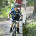 Walker Clark, 12, rides along the Slaughter Pen Trail in Bentonville Thursday as part of The New Sch...