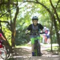 Jon Sanker, 11, rides Thursday along the Slaughter Pen Trail in Bentonville with others as part of T...