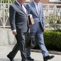 Attorneys W.H. Taylor (left) and John Elrod walk out of the Judge Isaac C. Parker Federal Building F...