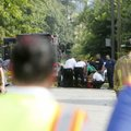 A shooting victim receives aid Friday at the intersection of Brown Street and Neal Street. Authorit...