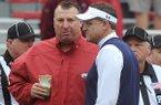 Arkansas coach Bret Bielema, left, talks with Auburn coach Gus Malzahn prior to a game Saturday, Oct. 24, 2015, at Razorback Stadium in Fayetteville.