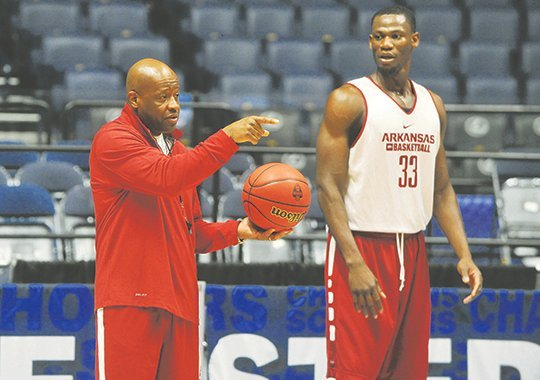 NWA Democrat-Gazette/Michael Woods HOG LEADERS: Arkansas coach Mike Anderson works with all-Southeastern Conference center Moses Kingsley and the rest of the Razorbacks during preparation for the SEC tournament March 9 in Nashville, Tenn. The Razorbacks' summer consists of school work and practice before an exhibition trip to Spain in August.