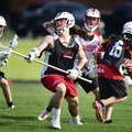 Caden McCarty (left to right) Parker Evans, Henry Holmes and Kyle Saelzer play a pickup game of lacr...