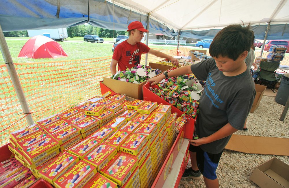 Clay Jones (left) and Javen Parker organize the fireworks displays Wednesday at Jake\u0027s Fireworks in Springdale. Some firework tent operators say they are ... & Fireworks tents open operators cautious