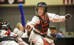 Jessica Wartberg, of Boco Raton, Fla. right, competes with Elisa Colon, of Jacksonville, Fla. in combat sparing at the American Taekwondo Association World Expo/ World Championships 2016 in this file photo.