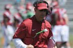 Arkansas offensive coordinator Dan Enos works with his players Saturday, April 23, 2016, during the annual spring Red-White game in Razorback Stadium.