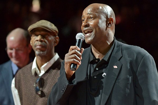 Arkansas basketball legend Sidney Moncrief speaks to the crowd during halftime of a game against Mississippi State on Feb. 7, 2015, at Bud Walton Arena in Fayetteville. Moncrief was honored with a replica of his jersey being hung in the rafters.