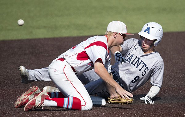 St. Thomas Aquinas base runner Blake Lillis was safe at second base after Shawnee Heights infielder Caleb Schiefelbein missed the ball during Kansas Class 5A baseball state tournament championship game Saturday, May 28, 2016.