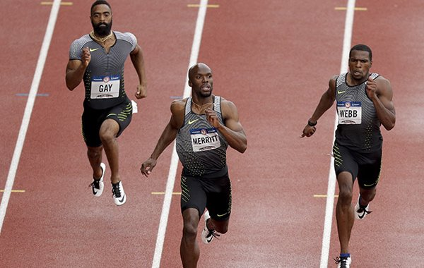 LaShawn Merritt, middle, second place Ameer Webb, right, and third place Tyson Gay finish during the semifinals in the men's 200-meter run at the U.S. Olympic Track and Field Trials, Friday, July 8, 2016, in Eugene Ore. (AP Photo/Charlie Riedel)