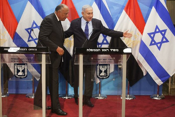 Egypt's foreign minister calls for peace in rare visit to Israel