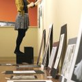 Eve Smith, director of visual arts at the Arts Center of the Ozarks, installs an art exhibit at the ...