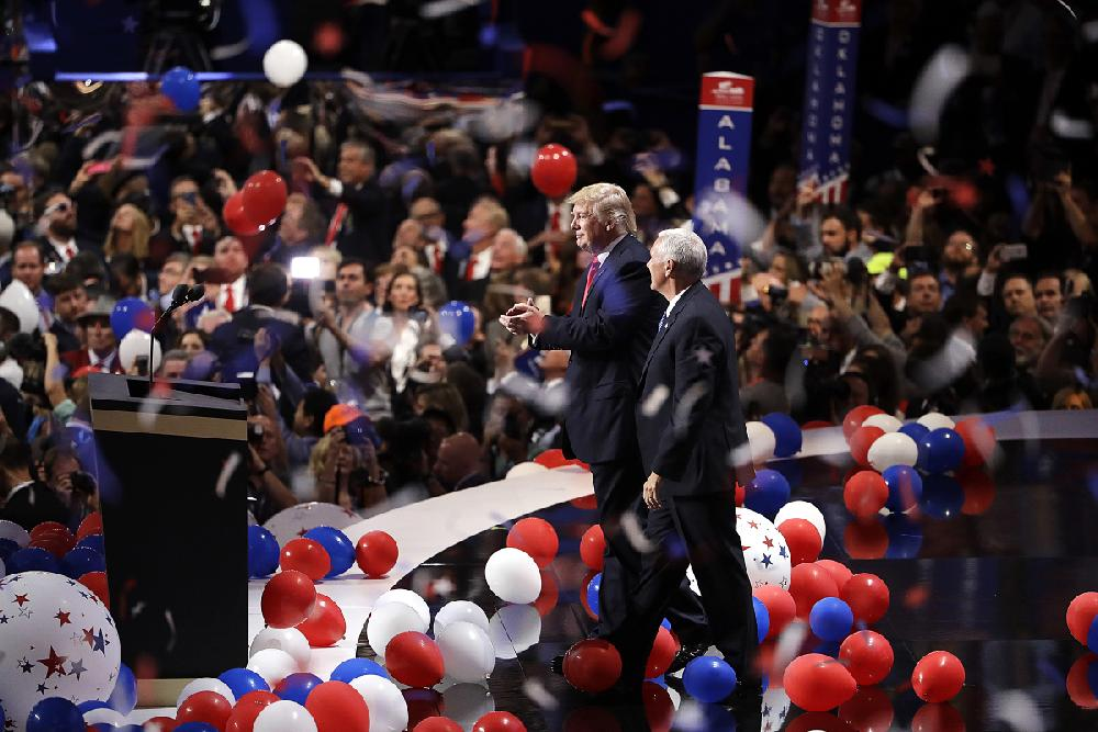 Donald Trump and running mate Mike Pence celebrate with ...