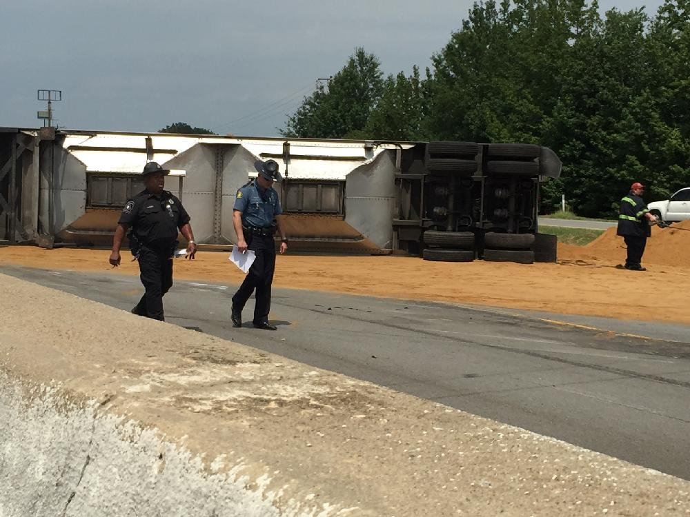 PHOTOS: Tractor-trailer overturns, shuts down part of I-40