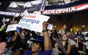 Georgia delegate Pat Pullar holds up a sign during the first day of the Democratic National Convention in Philadelphia , Monday, July 25, 2016.