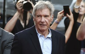 In this December 10, 2015 file photo, Harrison Ford greets fans during a Star Wars fan event in Sydney.