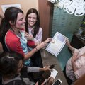 Kristin Seaton (left) and Jennifer Rambo laugh as Jane Osborn, Carroll County Deputy County Clerk, i...