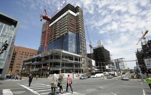 High-rises are under construction in Boston in this May file photo. The U.S. economy grew at a 1.2 percent annualized rate in the second quarter, the Commerce Department said Friday.