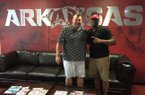 Arkansas head football coach Bret Bielema and defensive end Michael Taylor