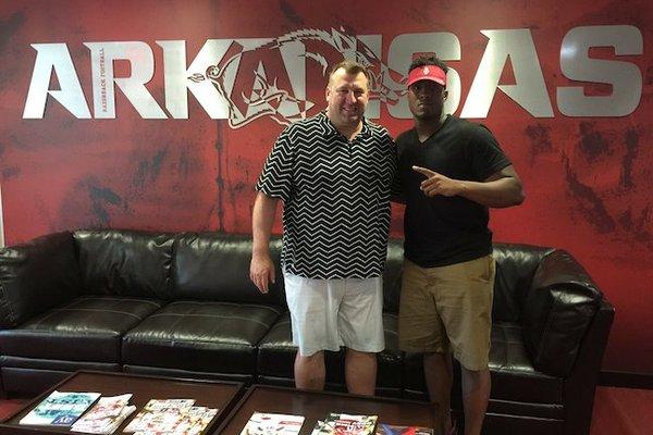 Arkansas head football coach Bret Bielema and defensive end Michael Taylor
