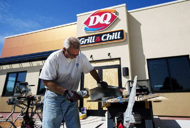 file-brooks-montgomery-works-on-a-piece-of-steel-at-the-dairy-queen-grill-chill-in-farmington