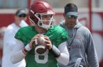 Arkansas quarterback Austin Allen participates in a drill as Dan Enos, Arkansas offensive coordinator and quarterbacks coach, looks on during practice Saturday, Aug. 6, 2016, at the football practice field on the university campus in Fayetteville. Visit nwadg.com/photos to see more photographs from the day's practice.