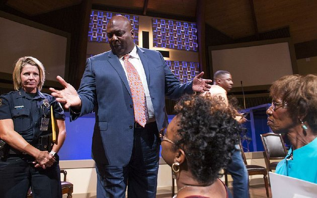 little-rock-police-chief-kenton-buckner-answers-questions-from-angel-smith-center-and-irene-gillespie-right-at-st-mark-baptist-church-in-little-rock-on-wednesday-buckner-answered-questions-by-the-community-along-with-other-panelists-during-a-conversation-titled-know-your-rights