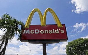 This Tuesday, June 28, 2016, photo shows a McDonald's sign in Miami. Already, the emergence of smaller rivals promising more wholesome alternatives has major restaurant chains scrambling to improve the image of their food. But some of the tweaks they're making underscore how far they have to go in changing perceptions. Convincing people it serves wholesome food is particularly important for McDonald's, which has long courted families with its Happy Meals and Ronald McDonald mascot. (AP Photo/Alan Diaz)