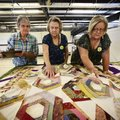 Myra Bell McGee (from left) helps judges Lennis Ledbetter and Joan Backman as they judge quilts Mond...