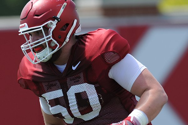 Arkansas offensive lineman Jake Raulerson participates in a drill during practice Saturday, Aug. 6, 2016, at the football practice field on the university campus in Fayetteville.